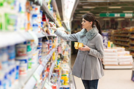 supermarket: Beautiful Young Woman Shopping For Fruits And Vegetables In Produce Department Of A Grocery Store - Supermarket - Shallow Deep Of Field Stock Photo