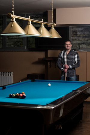 pool hall: Portrait Of A Young Man Concentration On Ball