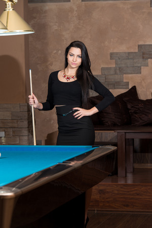 billiards hall: Portrait Of A Young Woman Playing Billiards