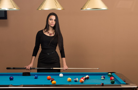 carves: Portrait Of A Young Woman Playing Billiards