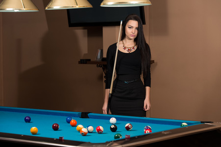 pool hall: Portrait Of A Young Woman Concentration On Ball