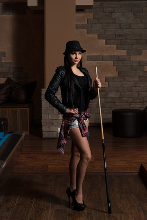 pool hall: Portrait Of A Young Woman Playing Billiards