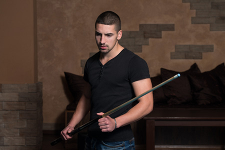 carves: Portrait Of A Young Man Playing Billiards