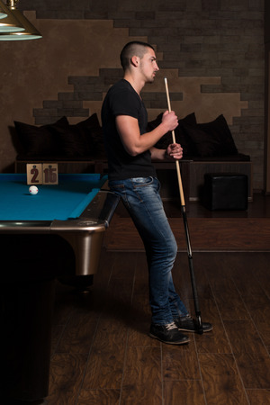 pool hall: Young Man Looking Confused Lost His Billiard Game