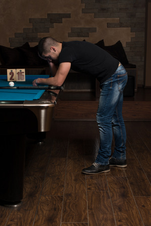 pool hall: Young Man Looking Confused At Billiard Table - He Is Losing