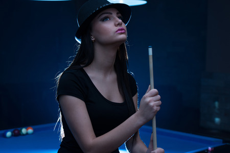 pool hall: Young Woman Looking Confused Lost Her Billiard Game