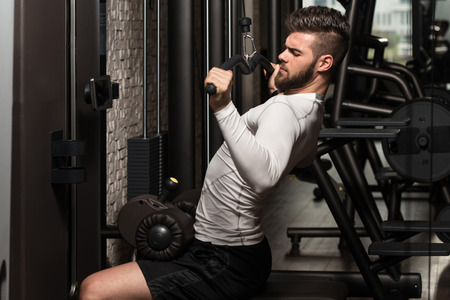 hairy back: Young Man Doing Heavy Weight Exercise For Back In Gym