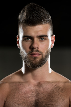 hairy chest: Portrait Of A Young Sporty Man In The Modern Gym With Exercise Equipment