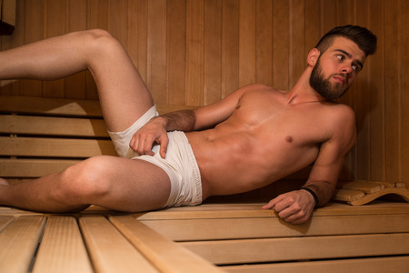 Happy Good Looking And Attractive Young Man With Muscular Body Relaxing In Sauna Hot Stock Photo