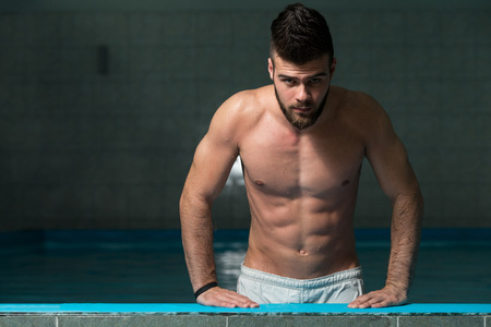 nude abs: Fashion Portrait Of A Very Muscular Sexy Man In Underwear At Swimming Pool Stock Photo