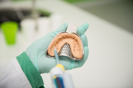 Close-up Shot Of Dental Impression With Implant Stock Photo