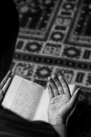 koran: Muslim Man Is Reading The Koran Stock Photo
