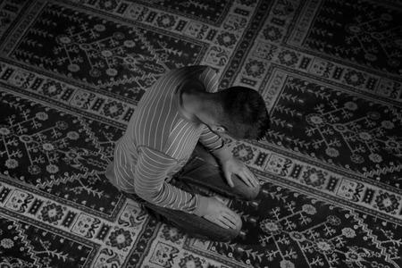 islamic prayer: Muslim Man Is Praying In The Mosque Stock Photo