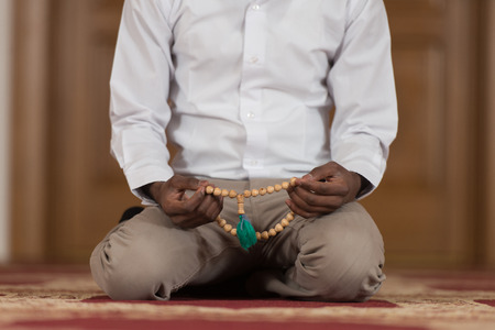 afro arab: Black African Muslim Man Is Praying In The Mosque Stock Photo