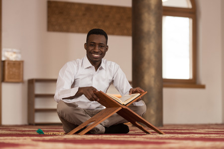 afro arab: Black African Muslim Man Is Reading The Koran