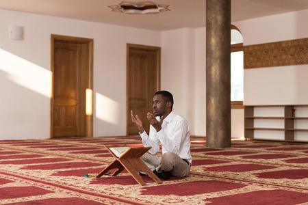 afro arab: Black African Muslim Man Is Reading The Koran