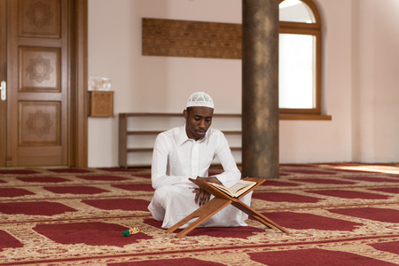 muslim: Black African Muslim Man Reading Holy Islamic Book Koran