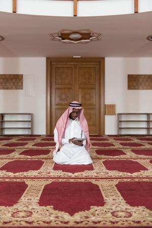afro arab: Arab Saudi Emirates Man Using A Smart Touchpad Stock Photo