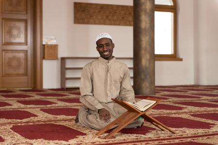 afro arab: Black African Muslim Man Reading Holy Islamic Book Koran