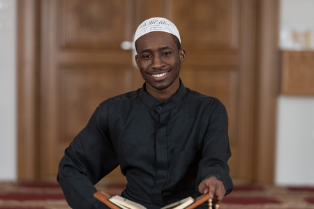 Black African Muslim Man Reading Holy Islamic Book Koran