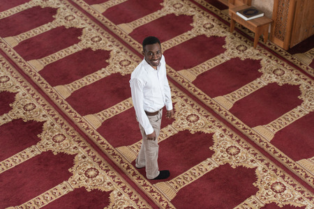 afro arab: Handsome Black Man Smiling Is Praying In The Mosque