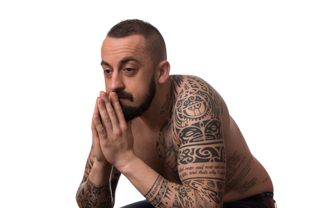 Portrait Of Young Man With Tattoo And Beard - Isolated On White Background Stock Photo