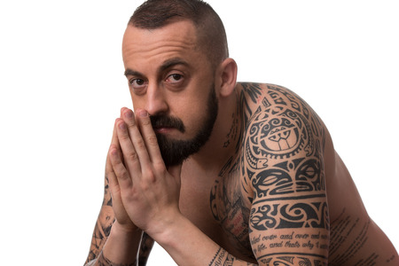 arm muscles: Portrait Of Young Man With Tattoo And Beard - Isolated On White Background Stock Photo
