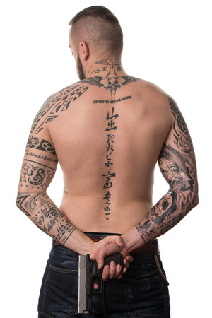 one armed: Back Rear View Tattooed Male With Gun On Isolated On White Background Stock Photo