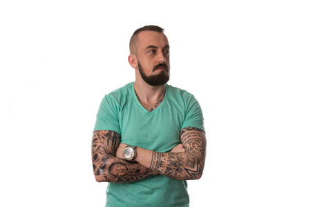Portrait Of Young Man With Tattoo And Beard - Isolated On White Background photo