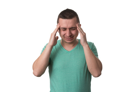 male headache: Frustrated Young Man With A Headache - Isolated Over White Background