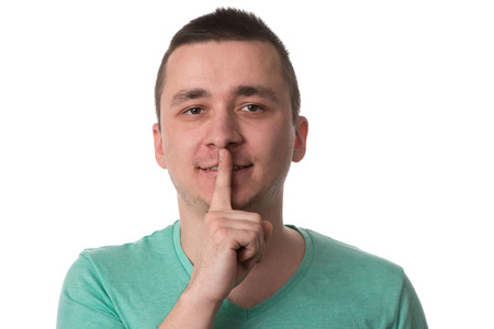 Portrait Of Young Handsome Man Quiet Gesture With Finger - Isolated On White Background photo