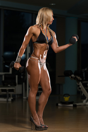 only the biceps: Mature Woman Working Out Biceps In High Heels - Dumbbell Concentration Curls