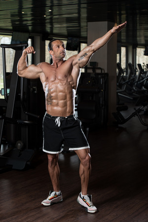 physically fit: Portrait Of A Physically Fit Man In Modern Fitness Center Stock Photo