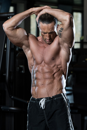 physically: Portrait Of A Physically Fit Man In Modern Fitness Center Stock Photo