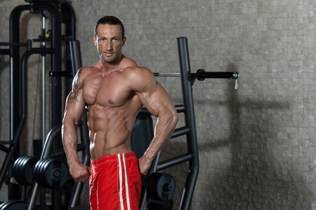 italian ethnicity: Portrait Of A Physically Fit Man In Modern Fitness Center Stock Photo