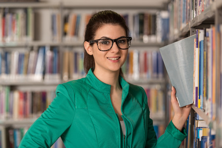 Portrait Of An Caucasian College Student Woman In Library - Shallow Depth Of Field photo