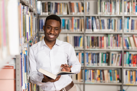 one  people: Portrait Of A College Student Man In Library - Shallow Depth Of Field