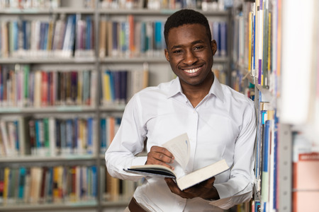 Portrait Of A College Student Man In Library - Shallow Depth Of Field