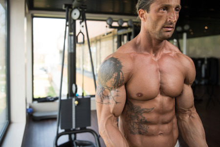 heavy weight: Muscular Mature Man Bodybuilder Doing Heavy Weight Exercise For Biceps