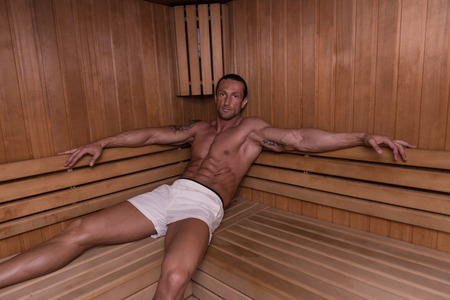 sauna nackt: Good Looking And Attractive Mature Man With Muscular Body Relaxing In Sauna Hot