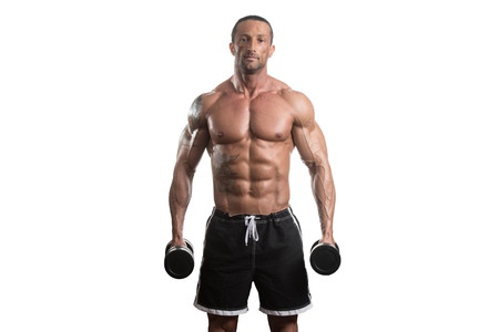 pectorals: Muscular Bodybuilder Guy Doing Exercises With Dumbbells Over White Background Stock Photo