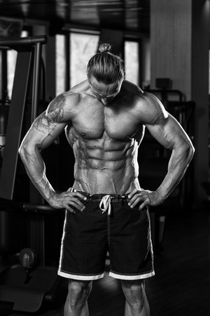 physically fit: Portrait Of A Physically Fit Man In Modern Fitness Center - Black And White Photo Stock Photo