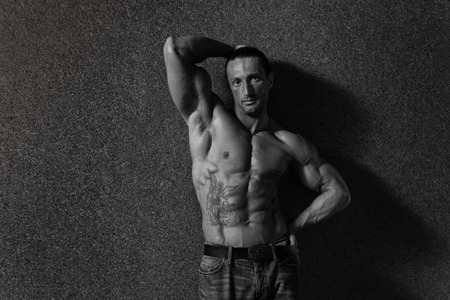 pectoral muscle: Portrait Of A Muscular Mature Man In The Modern Corridor Where He Poses