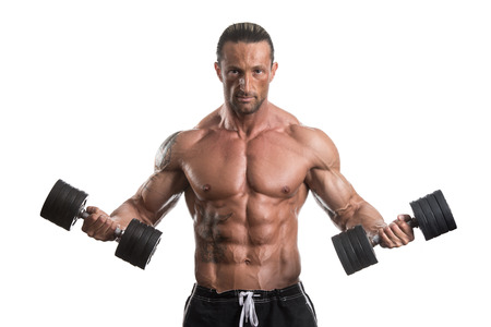 man lifting weights: Muscular Bodybuilder Guy Doing Exercises With Dumbbells Over White Background Stock Photo