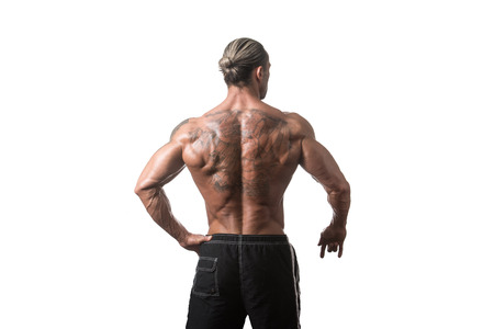 pectorals: Back Rear View Tattooed Male Bodybuilder On Isolated White Background