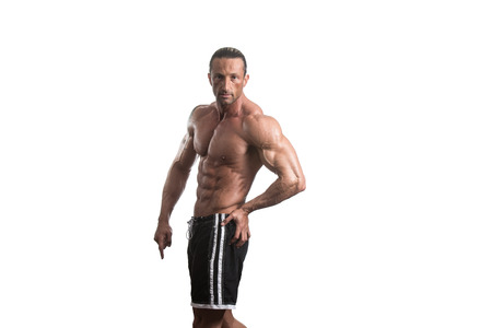 pectorals: Muscular Mature Man Posing In Studio - Isolated On White Background Stock Photo