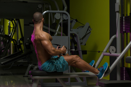 heavy weight: Muscular Man Doing Heavy Weight Exercise For Back