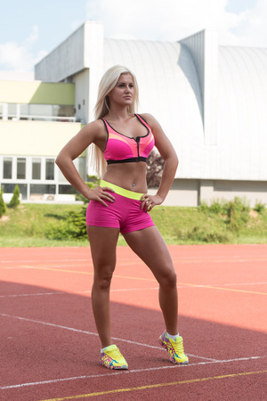 sports clothing: Young Woman In Sports Clothing After Outdoor Exercises Stock Photo