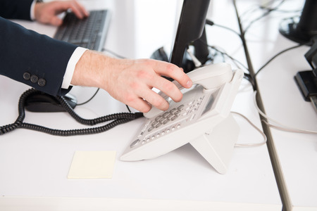 'pick up': Businessman Pick Up Or Hangs Up The Phone In The Office