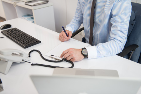 writing a letter: Young Businessman Writing A Letter Close Up - Notes Or Correspondence Or Signing A Document Or Agreement Stock Photo